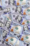 A large number of US dollar bills of a new design with a blue stripe in the middle. Top view royalty free stock photos