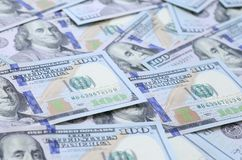 A large number of US dollar bills of a new design with a blue stripe in the middle. Top view.  stock photos