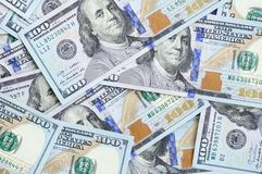 A large number of US dollar bills of a new design with a blue stripe in the middle. Top view.  royalty free stock images