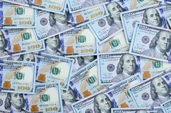 A large number of US dollar bills of a new design with a blue stripe in the middle. Top view.  royalty free stock image
