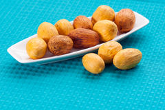 Large nuts on a plate Royalty Free Stock Image