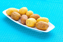 Large nuts on a plate Stock Images