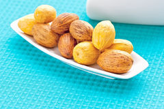 Large nuts on a plate royalty free stock photo
