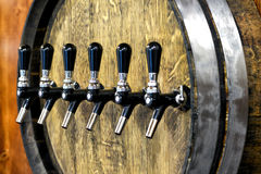 Large oak wine barrel with a row of spigots Stock Photo
