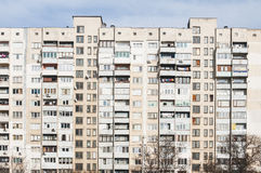 Large obsolete residential block. Large obsolete residential appartment block in a poor neighborhood Royalty Free Stock Image