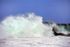 Large ocean wave. The crest and foam from a large ocean wave as it rushes towards shore Stock Photo