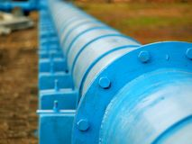 Large Oil Pipeline. A pipeline delivers fuel to an industrial complex Stock Photos