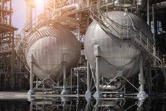 A large oil-refinery plant . A large oil-refinery plant with Liquefied Natural Gas LNG storage tanks Royalty Free Stock Images
