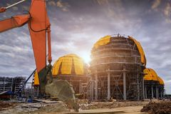 A large oil-refinery plant in construction . A large oil-refinery plant with Liquefied Natural Gas LNG storage tanks Stock Image