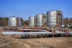 Large oil tank with valves and pipings Royalty Free Stock Images