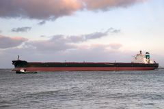 Large oil tanker shipping industry. Large oil tanker leaving the Port of Rotterdam Royalty Free Stock Images