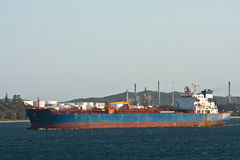 Large oil tanker under power in harbour. Royalty Free Stock Images