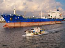 Large Oiltanker and Chinese Fishing Boat Royalty Free Stock Image