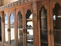 A large old antique antique wooden bookcase, documents in the Arab Islamic Mosque, a temple for prayers to GodA large old antique. A large old antique antique stock photos