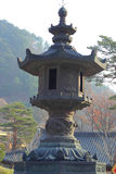 Large old antique lantern post Seoraksan Korea. Royalty Free Stock Images