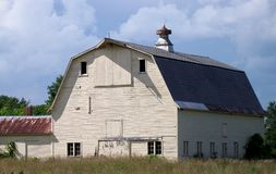 Large Old Barn in a field Stock Photo