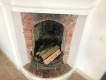 Large old beautiful antique vintage medieval stone fireplace stock image