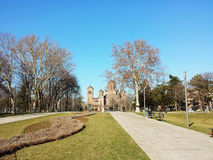Large old church in the distance. Various colors in the park royalty free stock photo