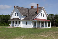 Large Old Colonial Style House. A large colonial style house sitting in the sunshine Stock Images