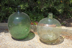 Large old glass jars. Old circular large glass jars Stock Image