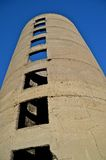 Large Old Poured Silo Throws it's Shadows Stock Image