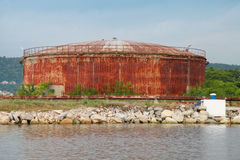 Large old rusted oil tank on the lake coast, Port of Varna Royalty Free Stock Photography