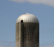 Large Old Silo against a blue sky Stock Image