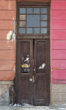 Large and old wooden doors decorated with lattice and transom Royalty Free Stock Photos