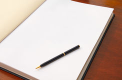 Large open book on wood table Stock Images