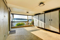 Large open covered garage storage area with closets and rock flo Royalty Free Stock Photography