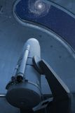 Large optical telescope pointing at the Whirlpool galaxy Stock Images