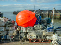 Large orange buoy on fishing canisters in Whitstable harbour Royalty Free Stock Photo
