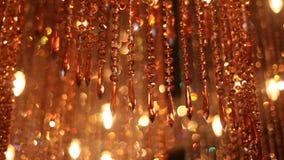 Large orange chandelier of glass stock footage