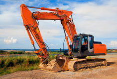 Large orange excavator royalty free stock photos