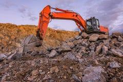 Large orange excavator in an outdoor mine stock photo