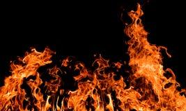 Large orange fire on black Stock Images