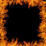 Large orange flame isolated on black Royalty Free Stock Photography