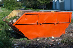 Large orange garbage container Stock Images