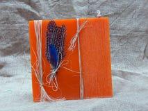Large orange wax candle Stock Photography