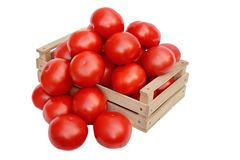 Large organic rose tomatoes in the wooden crate Stock Image