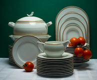 Large ornamented china tea-set with tomatoes Royalty Free Stock Photo