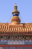 Large ornamented object on rooftop of a building, Buddhist temple, Beijing, China. Large ornamented object on rooftop of a building in a Buddhist temple, Beijing Stock Photography