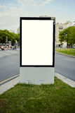 Large outdoor billboard stands at a busy intersection Stock Photos