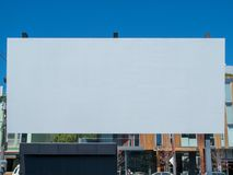 Large outdoor blank canvas movie screen displayed in a city park royalty free stock photo