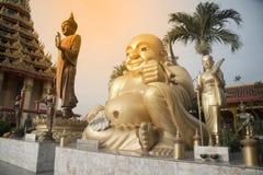 Outdoor happy Buddha on Wat Sangkas Ratanakhiri temple. Large outdoor happy Buddha on Wat Sangkas Ratanakhiri temple royalty free stock photography