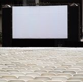 Large Outdoor Screen and Chairs Stock Photo