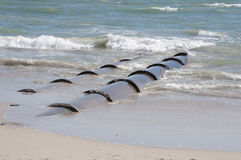Large outflow pipes discharging effluent into the sea Royalty Free Stock Image