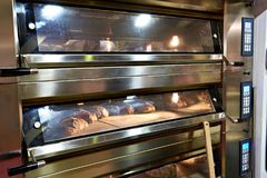 Large oven for baking bread in bakery stock images
