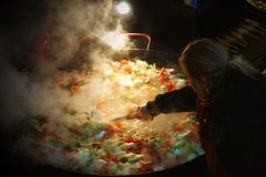 A large pan of paella, being made stock photo