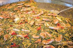 Large pan of paella in a street tray with food. Large pan of paella in a street tray with food royalty free stock photos